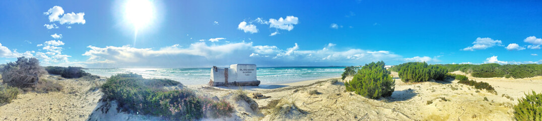 blue sky over sandy es trenc beach mallorca