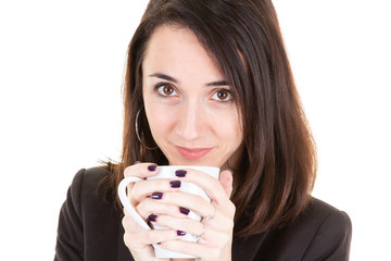 Close up thoughtful young woman smelling aroma coffee drink in mug cup