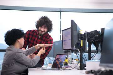 software developers couple writing programming code