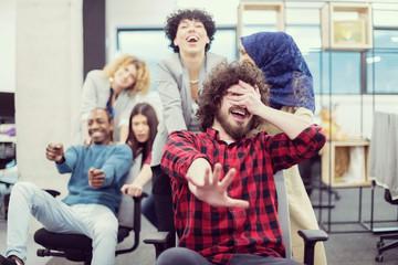 multiethnics business team racing on office chairs