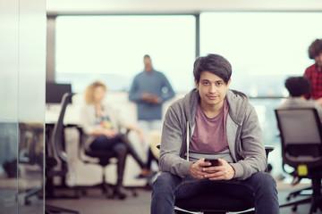software developer using mobile phone