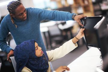 young black muslim female software developer at work