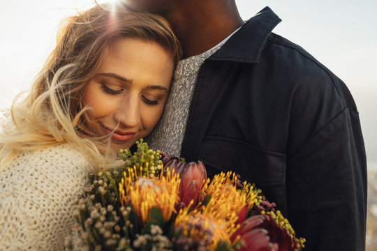 Woman hugging her man with love
