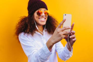 Wall Mural - African girl taking a selfie