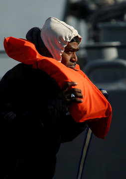 A migrant removes a life jacket after disembarking from an Armed Forces of Malta (AFM) patrol boat which rescued 87 migrants, at the AFM's base at Haywharf in Valletta's Marsamxett Harbour