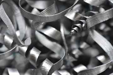 A lot of metal shavings close-up, after working on a milling machine or CNC machine. Texture metal shavings macro