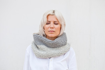 Pretty young woman in warm grey wool knitted snood