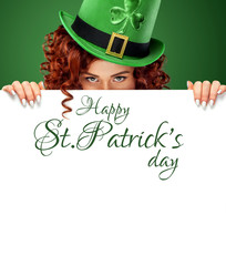 St Patrick's Day. Young sexy ginger Oktoberfest waitress on green background with banner for copy space