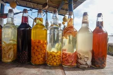 Homemade liqueur in glass bottle at Atins, Brazil