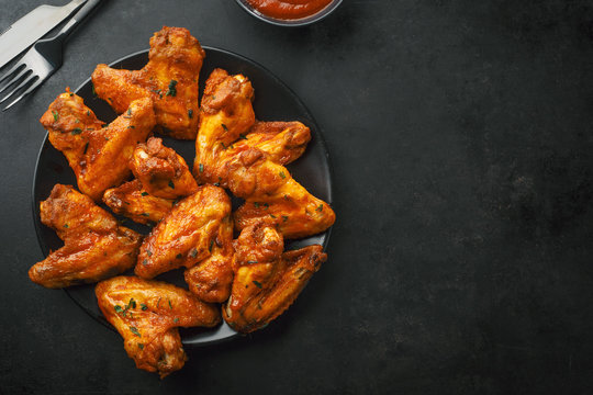 Chicken wings grilled in sauce on plate
