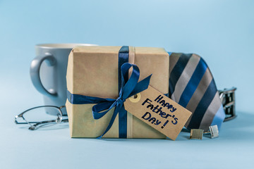 Fathers day concept - present, coffee, tie, mustache copy space