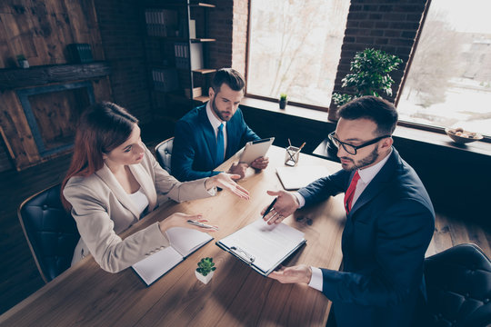 Above high angle view portrait of three nice elegant stylish beautiful handsome serious busy executive top sales managers contract sign agreement experts in loft industrial interior work place station