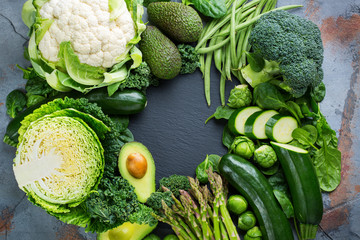 Assortment of organic green vegetables, clean eating vegan concept