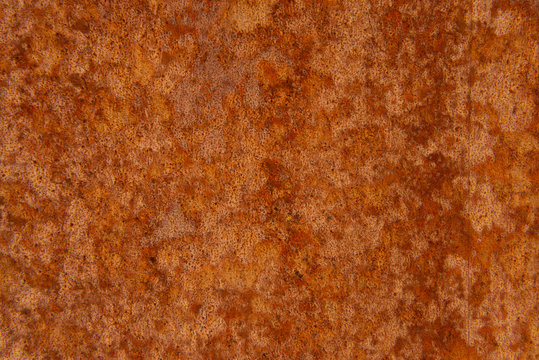 Old Distressed Brown Terracotta Copper Rusty Stone Background with Rough Texture Multicolored Inclusions. Stained Gradient Coarse Grainy Surface