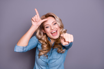 Close-up portrait of her she nice cute lovely charming attractive wavy-haired cheerful lady showing mocking sign gesture opened mouth isolated over gray violet purple pastel background