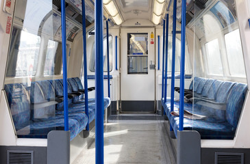 London - Februari 22: Inside of a metro coach on Februari 22, 2019 in London. London Underground is the 11th busiest metro system worldwide with 1.1 billion annual rides.