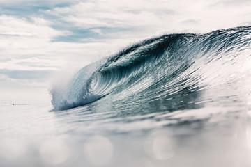 Ideal ocean wave. Breaking barrel wave and sun light