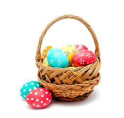 Perfect colorful handmade easter eggs in the basket isolated