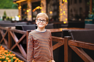 Young elementary boy with blonde hair and glasses