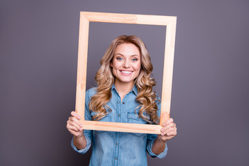 Portrait of her she nice-looking cute charming winsome fascinating attractive cheerful cheery wavy-haired lady holding in hands frame comfort cozy life zone isolated over gray background