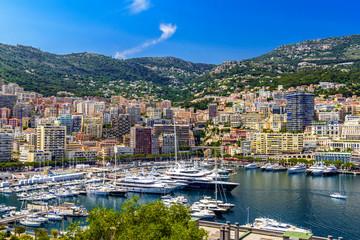 Yachts in bay near houses and hotels, La Condamine, Monte-Carlo, Monaco, Cote d'Azur, French Riviera