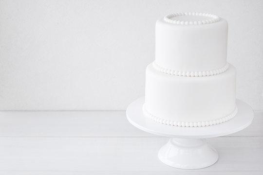 White wedding cake blank on a white background. Simple minimalism.