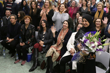 Mariam Shaar, a Palestinian entrepreneur, holds a bouquet of flowers after the screening of the documentary in Beirut
