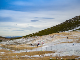 Unrecognizable people gliding on the ice in a slope on the mountain on La Covatilla, Bejar (Salamanca)