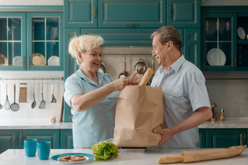 Retired couple after visiting supermarket