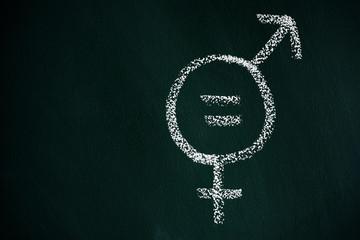symbol for gender equality on a chalkboard