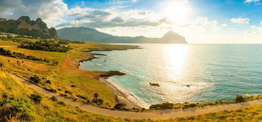 View of mountains and blue sea in the Italian natural reserve or Riserva dello Zingaro at sunset lights in Sicily, Italy