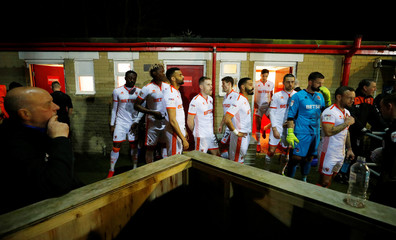 The Blackpool team leaves their changing rooms ahead of their soccer match against Accrington Stanley at the Wham Stadium in Accrington