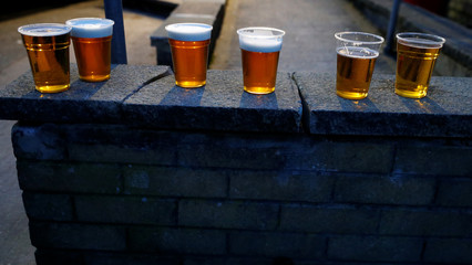 Supporters beer glasses are seen on a wall outside the ground ahead of the soccer match between Accrington Stanley and Blackpool at the Wham Stadium in Accrington