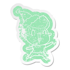 cartoon distressed sticker of a excited man wearing santa hat