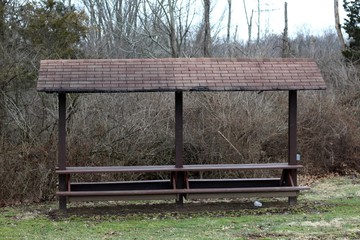 The old wooden picnic shelter in the park.