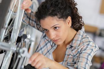 woman fixing a bike
