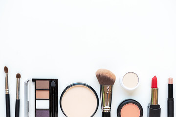 Makeup cosmetics tools background and beauty cosmetics, products and facial cosmetics package lipstick, eye shadow on the white background. Lifestyle Fashion Concept Wall mural