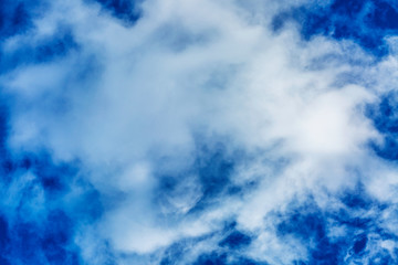 Bright blue sky with big cloud, background