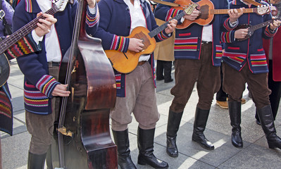 Traditional Croatian musicians in Slavonian costumes play in the city square