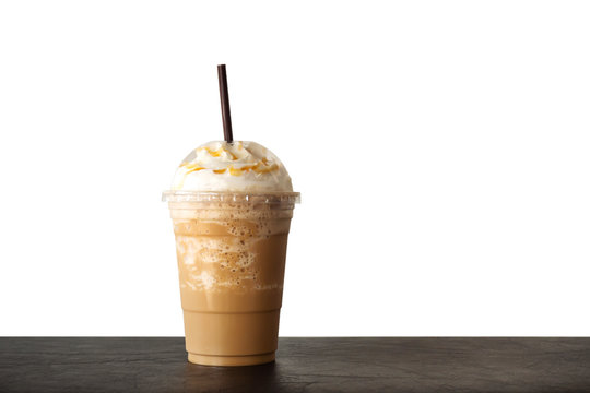 Cappuccino blended in plastic cup. Served with whipped cream. Refreshment drink. Favorite caffeine beverage.