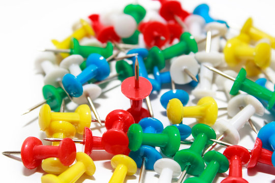 Colorful pushpins on white background