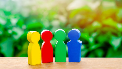 Four colorful figures of people talking. International cooperation, joint project. The concept of cooperation and mutual assistance.teamwork and partnership Selective focus