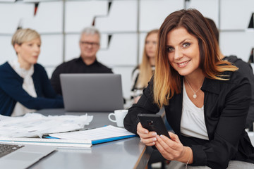 Attractive businesswoman taking time out