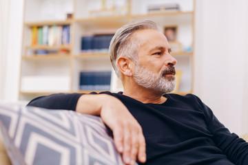 Senior bearded man relaxing at home