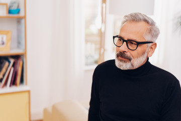 Pensive senior man wearing glasses