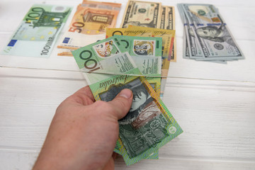 Australian dollar banknotes in hand giving for exchange