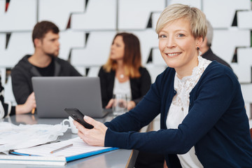Attractive businesswoman with friendly smile