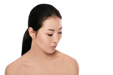 spa portrait of beautiful young asian woman with on white background closeup. girl with clean skin