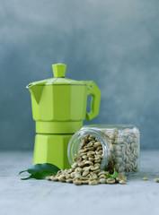 organic green coffee grains on gray background