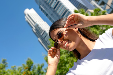 Portrait of a young woman in sunglasses on a sunny day